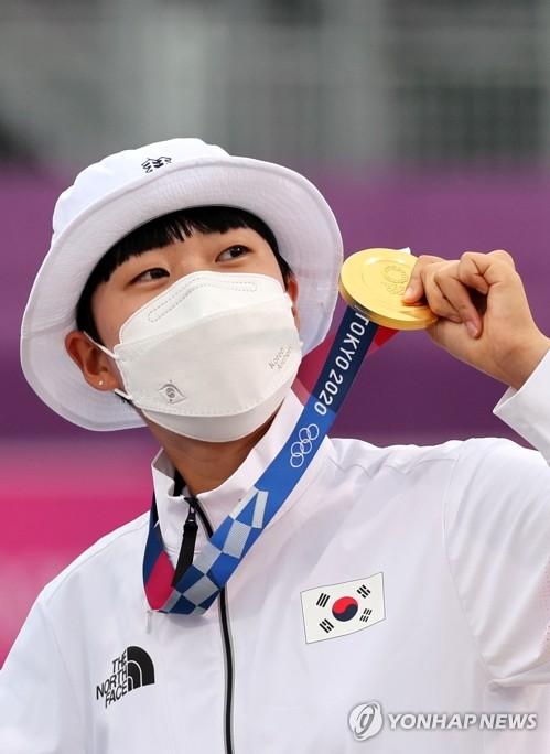 重压下韩国射箭小将安山夺三金创造历史
