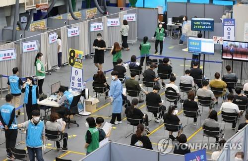 韩国首剂新冠疫苗接种率达77.3%
