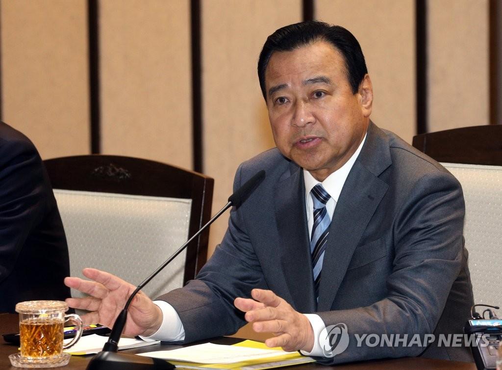 资料图片:韩国前国务总理李完九 韩联社