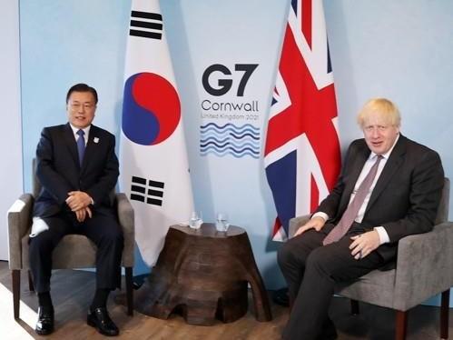 韩英领导人商定加强合作争取公平分配疫苗